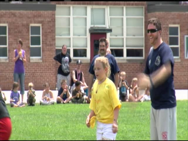 Students play kickball against police and firefighters_76389731-159532