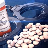 pills and handcuffs-794306122