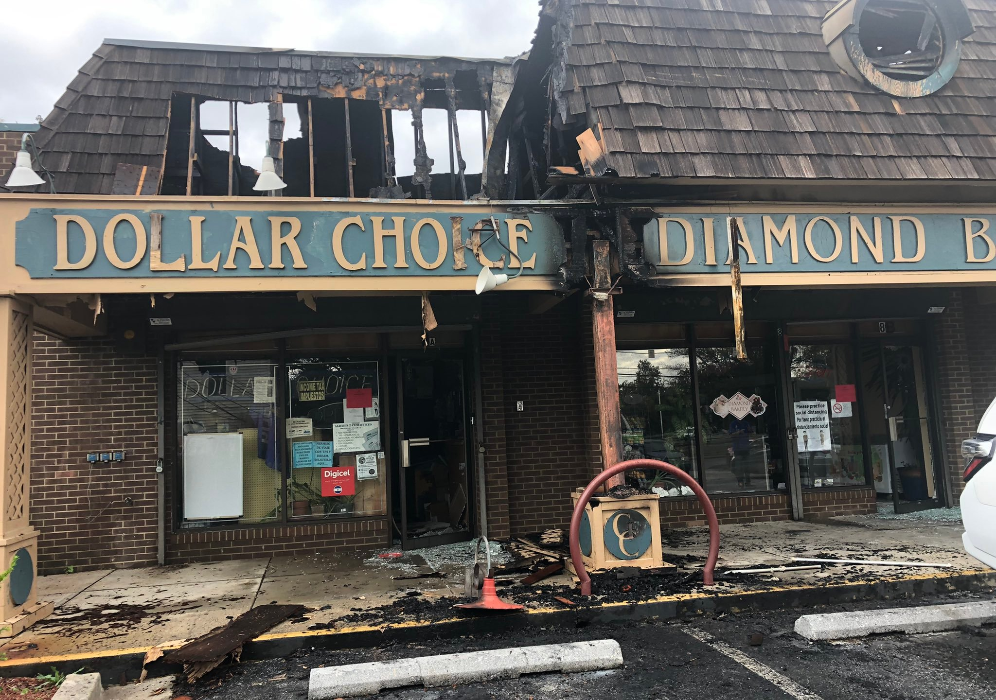 Storefronts at a strip mall after a fire in Gaithersburg