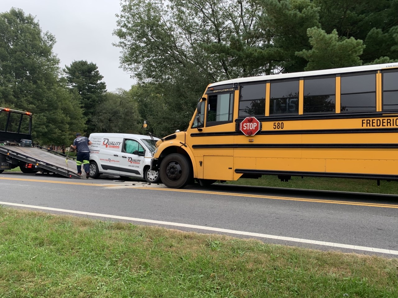 A white van and a school bus were involved in a head-on collision.